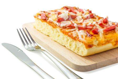 Homemade delicious fresh a slice of pizza on wooden plate ready to eat with isolated on white background, closeup.