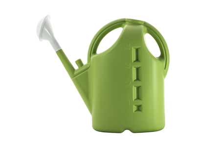 Green plastic watering can isolated on white background.