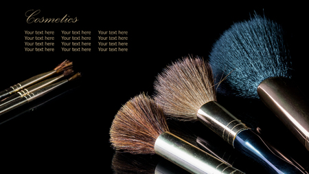 reflexion: Makeup brush on professional cosmetic isolated on black background with reflexion.