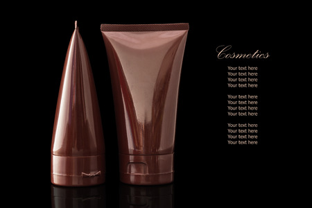 reflexion: Brown colored blank cosmetic container for face cream moisturizer isolated on black background with reflexion.