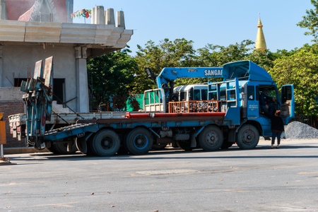 Bangkok, Thailand. - October 2, 2016: Blue crane truck and white automobile crane in Wat Phutthabucha construction site, Thung Khru, Bangkok, Thailand. Editorial