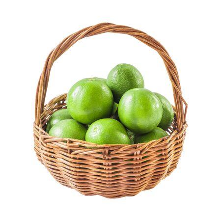 lemon wedge: Green lemon in the basket isolated background