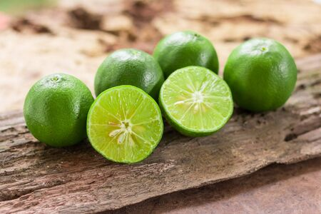 Lemons - Green lemons from the garden on wooden background Stock Photo
