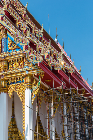 most creative: Temple roof vintage Thai style with against blue sky background - Art architecture being restored Temple roof of Wat Phutthabucha in Thung Khru, Bangkok, Thailand. Side view.