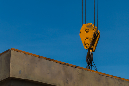 Yellow crane hook in Wat Phutthabucha construction site, Thung Khru, Bangkok, Thailand. Stock Photo