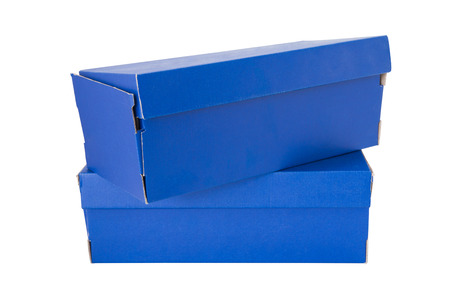 Blue shoe box isolated on white background. Include clipping path in both objects.