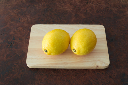 Lemons - Fresh of lemons on a rustic wooden table background with copy space, Selective focus. Stock Photo