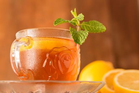 Lemon Teacup with lemon slices and mint leaf on a wooden background. Beverage concept, Close-up, Selective Focus Stock Photo - 98368076