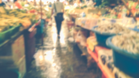 Abstract blur market - Abstract blurred for the people along walking on the narrow street at the morning market. Vintage-style. Stock Photo - 98427829