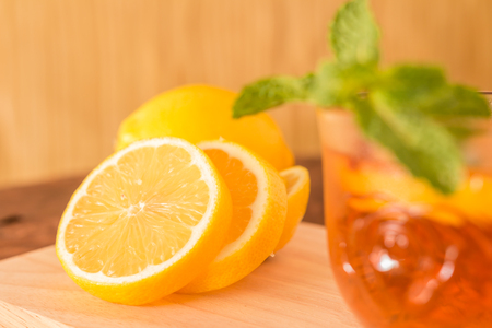 Lemon and Lemon Teacup with lemon slices and mint leaf on a wooden background. Beverage concept, Close-up, Selective Focus