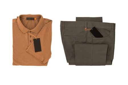 Brown shirt and Gray folded trousers - New Gray folded trousers and Brown shirt fashion with tag price isolated on white background. Lifestyle and fashion concept. File including clipping path.