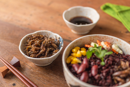 Insect and Rice Berry - Cricket insect, Corn, Red bean, Carrot, Cucumber with Rice Berry in a bowl. Healthy meal high protein diet concept. Close-up, Selective focus. Stock Photo