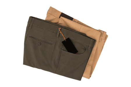 Gray and brown folded trousers - New gray and brown folded trousers fashion with tag price isolated on white background. Lifestyle and fashion concept.  File including clipping path.