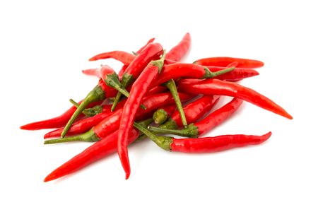 Red chili peppers - Group of red chilies on white background. Close-Up, Selective focus.
