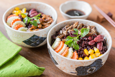 Insects food with Rice Berry - Cricket insects, Corn, Red bean, Carrot, Cucumber with Rice Berry in a retro bowl and green table napkin. Healthy meal high protein diet concept. Selective focus.