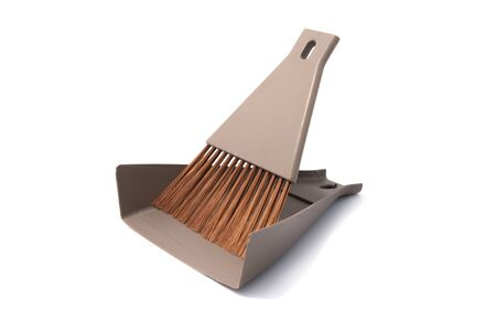 Brown set of brush and dustpan, household cleaning utensil with isolated on white background.