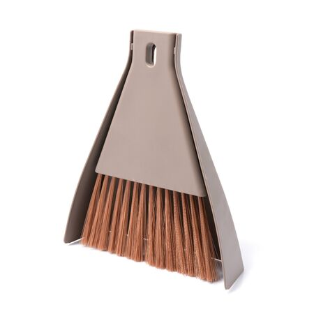 Small plastic hand dustpan and brush cleaning isolated on white background.