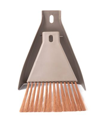 Small broom and dustpan household cleaning set isolated on white background. Stockfoto