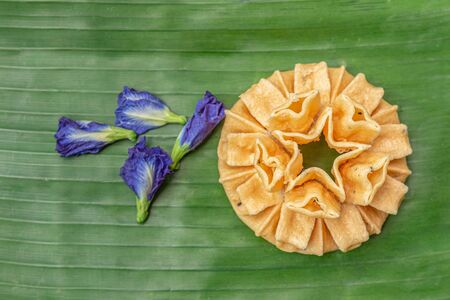Crispy lotus blossom cookies isolated on white. Thai traditional snack. Top view. Thai homemade cookies. Zdjęcie Seryjne