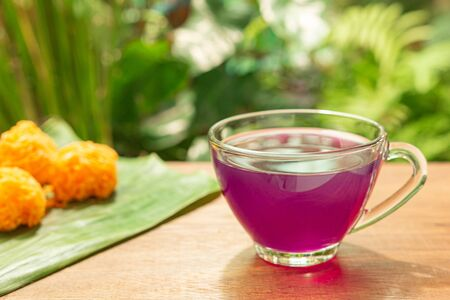 Cup of Blue pea drink or Butterfly pea flower for healthy drinking with Thai traditional dessert. Health drink concept. Selective focus. Zdjęcie Seryjne
