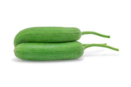 Gourd vegetable, Luffa or Sponge gourd isolated on white background with clipping path. Selective focus.