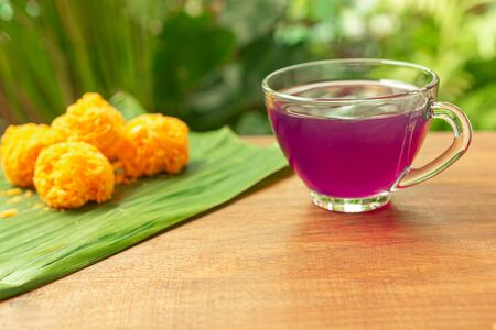 Cup of Blue pea drink or Butterfly pea flower for healthy drinking with Thai traditional dessert. Health drink concept. Selective focus. Zdjęcie Seryjne - 132103625