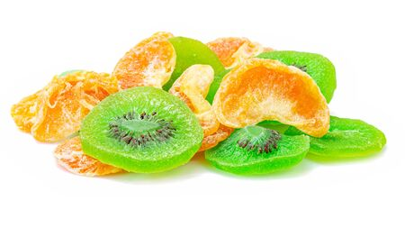 Fruit drying, Pile of dried tropical KIWI and Orange fruits isolated on the white background.