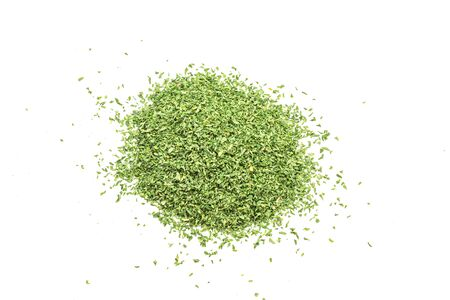 Heap of dried parsley leaf isolated on white
