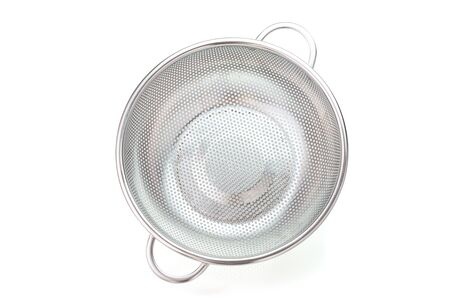 Stainless steel colander isolated on white