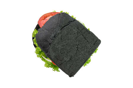 Homemade black bread sandwiches on a wooden kitchen board isolated on white background. Top view.