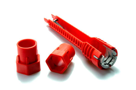 Red pipe wrench isolated on white background. Selective focus. Stock Photo