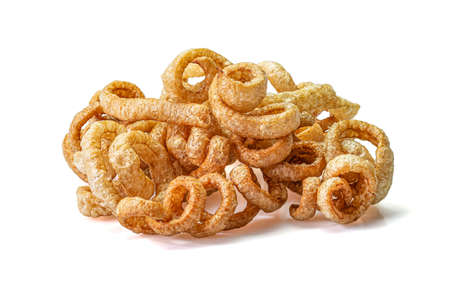 Pork snack or Pork rind leather lean pork fried crispy and blistered isolated on white background. Thai food, Close-up