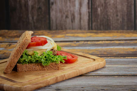 Homemade sandwiches on wooden cutting boards, Delicious breakfast with copy space.