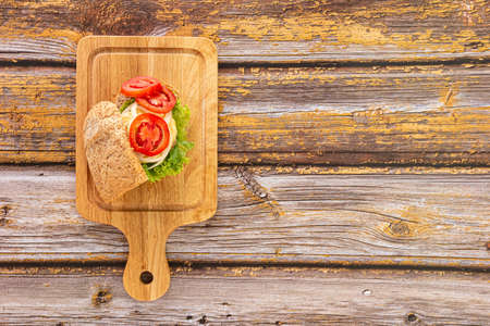 Sandwich bread with Cheese, Ham, Tomato, Salad, Onion isolated on white background. Top View.
