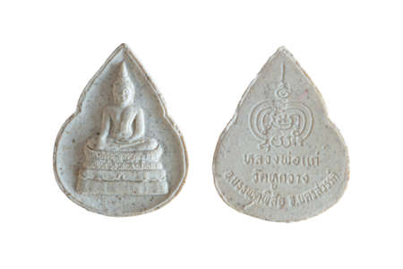 Amulets, Thai Buddha amulet, or votive tablet, made of metal or terracotta isolated on white background. The amulet is popular for Thai people as a tool to help enhance luck in different aspects of life