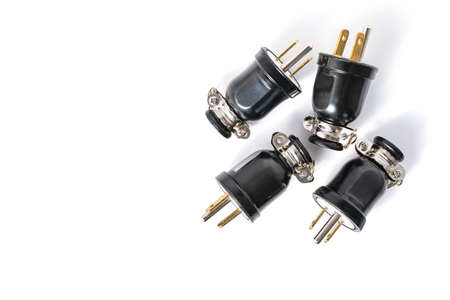 Black electric connect plugs isolated on white background with copy space for text.