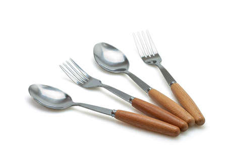 Spoon and fork isolated on with background. Selective focus. Stock Photo