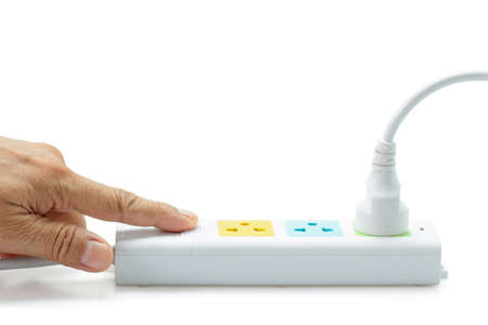Close-up, Hand-ready to turn on the switch for power strip on white background. Stock Photo