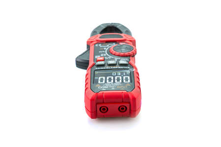 Testing electric digital clamp meter isolated on white background.