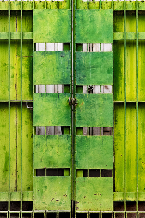 metal gate: Tarnished green metal gate, Mandalay, Myanmar Stock Photo