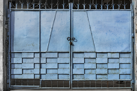 metal gate: Blue metal gate, Mandalay, Myanmar Stock Photo