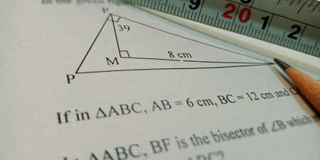 trigonometry triangle maths educational text displayed on paper in english language on numerical format background. Stock Photo