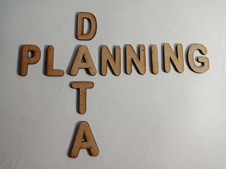 Data planning word presented on white surface with wooden cross text cloud frame art business learning background.