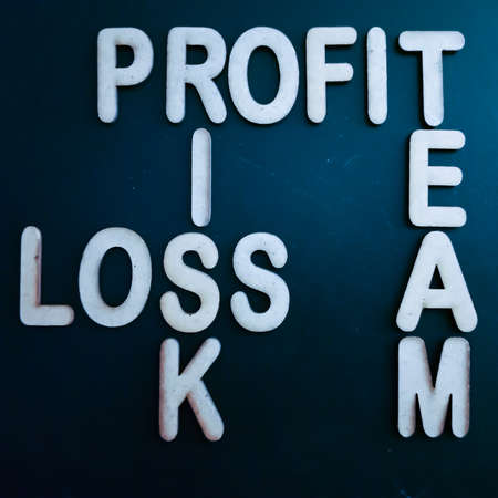 Profit team risk loss business word presented with cross text art black 3d pattern for learning purpose. Archivio Fotografico