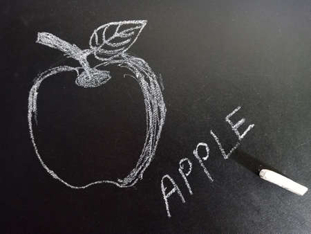 Apple word with image displayed on black board for learning and awareness terminology for education purpose.