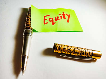 Equity word displayed on paper slip concept for educational informative awareness.