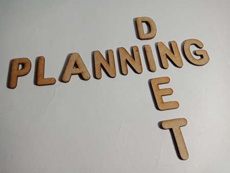 Diet Planning word display with cross wooden alphabet concept for informational awareness.