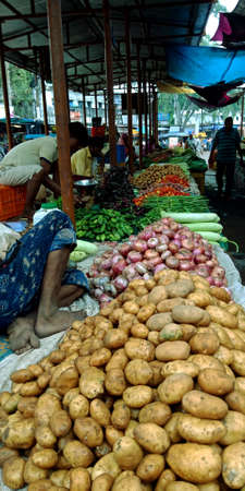 DISTRICT KATNI, INDIA - AUGUST 14, 2019: Asian village poor people selling potato and onion at indian vegetable green fresh agriculture produce market.