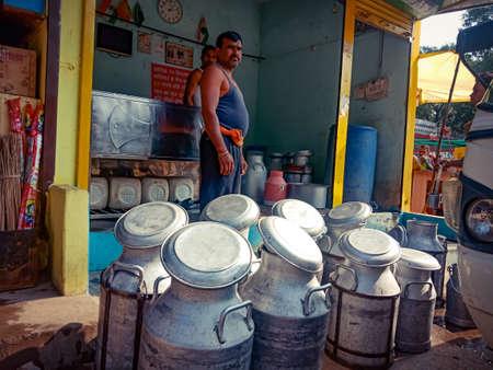DISTRICT KATNI, INDIA - OCTOBER 06, 2019: Milk container kept at milk shop on road side. Редакционное