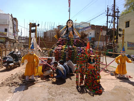 DISTRICT KATNI, INDIA - MARCH 21, 2020: Holika dahan preparation on road with cow-dung cries on road.